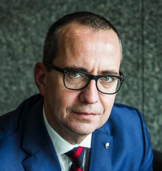Broker Consulting, Július Rusňák, generálny riaditeľ